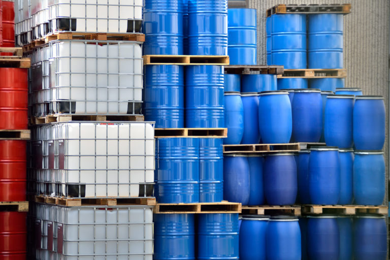 Shot of stacked containers in a large distribution warehouse